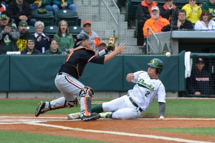 Runs were tough to come by in the Civil War series as Brett Thomas scores on a close play at the plate.