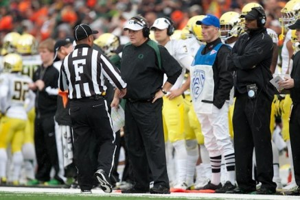 Official explaining the situation to Coach Chip Kelly