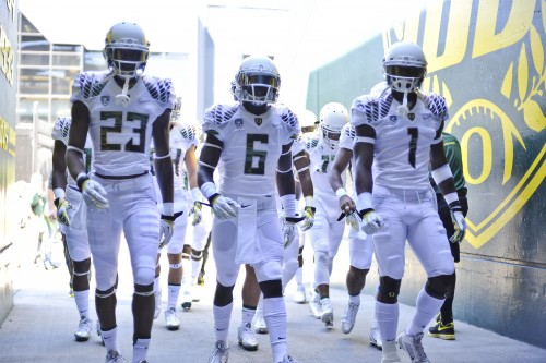 The Ducks went with all-white uniforms to kickoff the season on a sizzling day in Eugene.