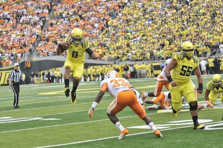 Mariota hops over a helpless UT defender