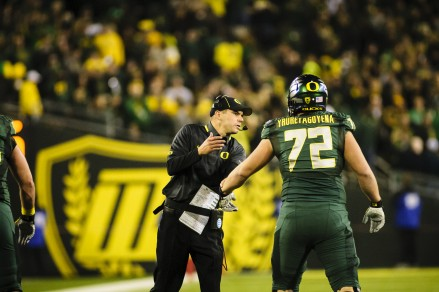 Photo: Craig Stroebeck Coach Helfrich asks Andre exactly how to pronounce his name.
