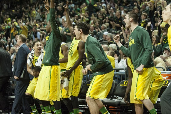 The Oregon bench celebrates during a win over Arizona
