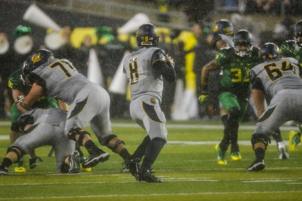 Cal players in the waterfall of the Oregon-Cal game