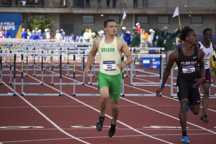 Devon Allen finishes his heat of the 110 meter hurdles in first place.