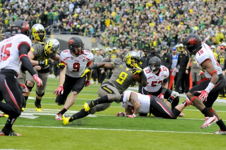 Byron Marshall trying to escape from the Utes in the 2013 game.