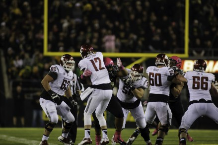 QB Connor Halliday being knocked down by a Duck player