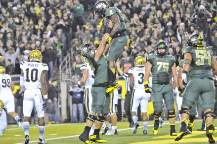 Byron Marshall celebrates after scoring a touchdown against UCLA.