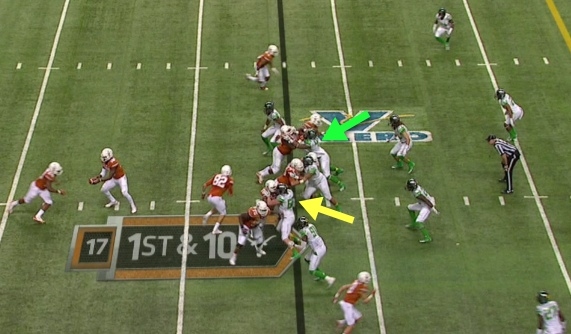 The Duck defensive ends check their gaps!