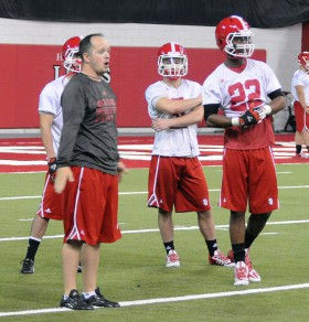 Coach Jason Petrino coaching up his players in practice