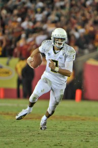 Marcus Mariota running for a touchdown.