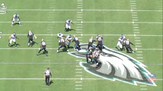 Cox attacks the left guard, while Logan (#96) loops around the left tackle.