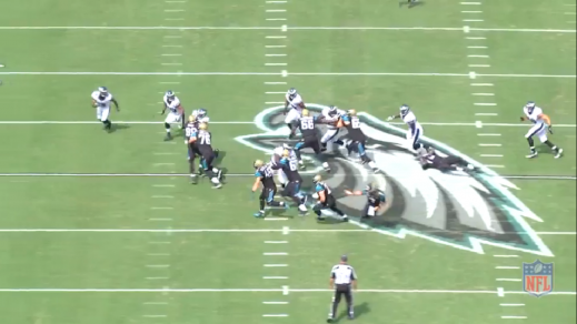 Cox uses a bull-rush to close in on Jacksonville running back Toby Gerhart.