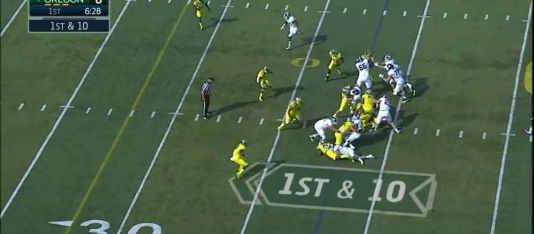 Walker makes the tackle at the line of scrimmage.