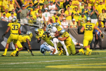 Oregon defense gang tackles MSU ball-carrier