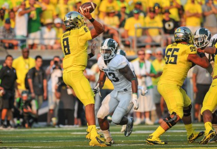 Despite heavy pressure Marcus Mariota led the Ducks offense with 3 TD's against Michigan State.