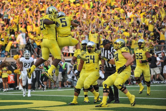 Oregon celebrates a touchdown against Michigan State.