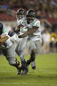 Royce Freeman (21) using his block to the outside.