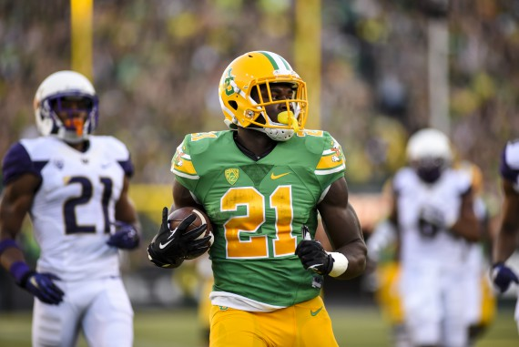 Royce Freeman ran all over Washington with 169 yards and four touchdowns.