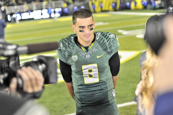Marcus Mariota in front of the media.