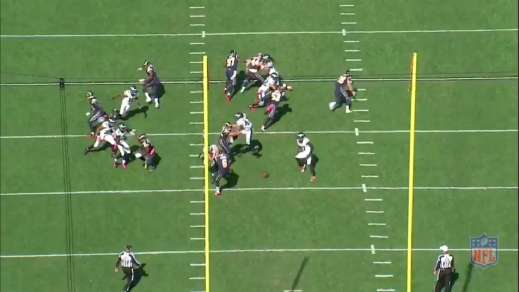 The personal protector blocks Burton, allowing Casey to block the punt.
