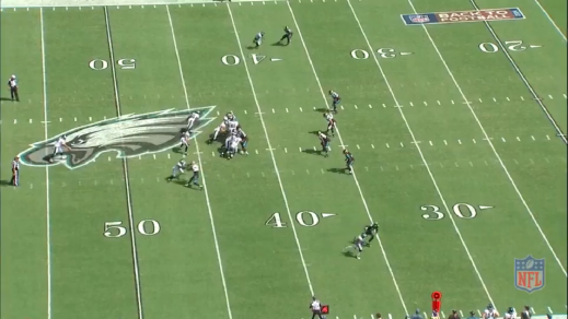 Boykin jukes and sprints to the right of the Jaguars player.
