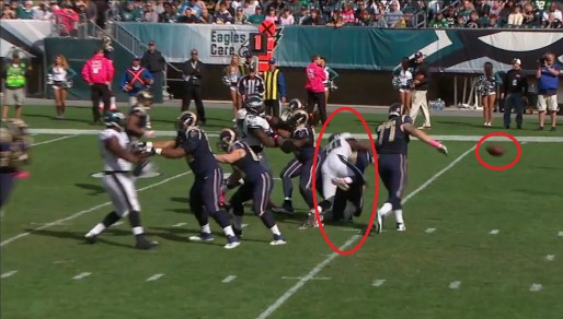 Trent Cole smashes Austin Davis but only after knocking the ball away