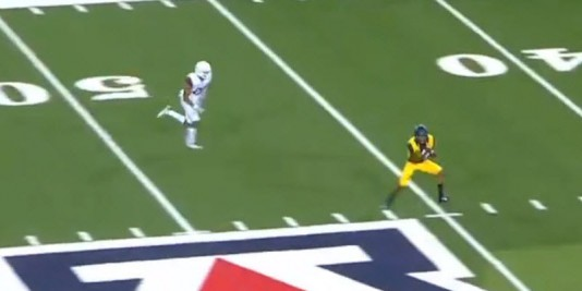 The receiver beats his man and it's and easy pitch and catch for Cal