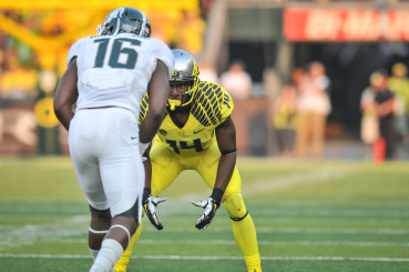 Ifo Ekpre-Olomu (14) lines up against Michigan State.