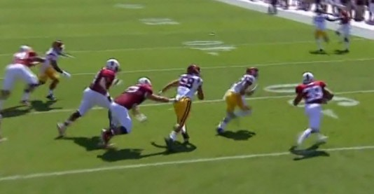 The running back beats USC to the edge and turns it upfield