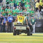 Andre Yruretagoynea (72) carted off due to lower leg injury in Michigan State game.