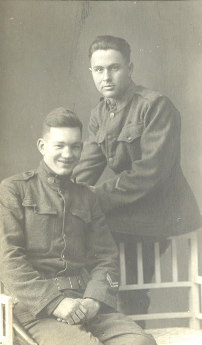 My grandfather, Aubrey Morse (seated) on his way to the front, 1917.