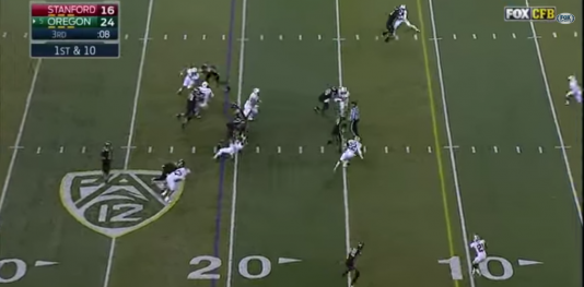 Grasu drives the linebacker backwards several yards, allowing Tyner to run free up the middle.