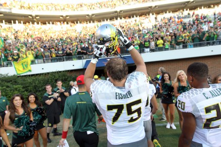 Offensive Lineman Jake Fisher (75) celebrates after a win vs. Virginia in 2013.