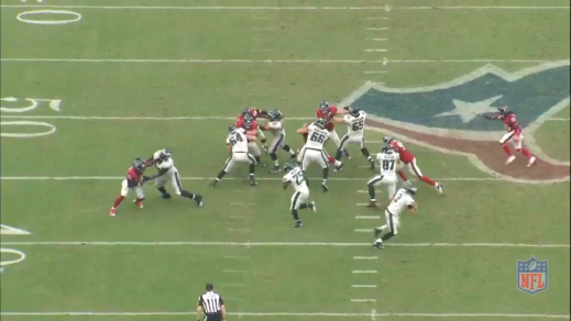 Kelce gets his hands on the linebacker to gain leverage against him.