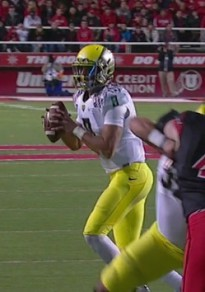Marcus Mariota about to pass for a TD.