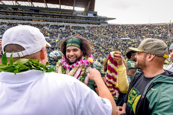 Mark Helfrich congratulates Hamani Stevens before his final home game of an Oregon career spanning seven seasons.