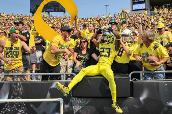 BJ Kelley celebrates with the fans against Michigan State