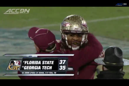 Jameis Winston and coach Jimbo Fisher hug after winning the ACC title