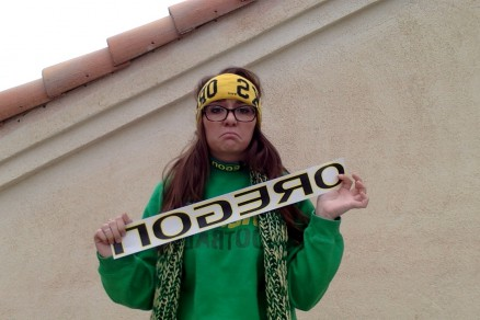 Yes, I am wearing a dog collar and holding up a car decal. True fan?