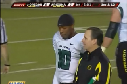 Dennis Dixon helped off the field against Arizona