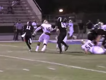 Travis Waller, 11, beats the defenders to the edge for a TD