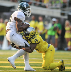 Ekpre-Olomu makes another tackle, vs. Michigan State.