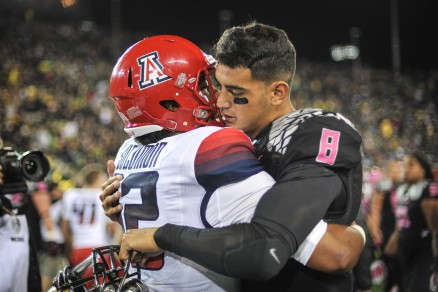 Mariota and an Arizona player after the game earlier this season.