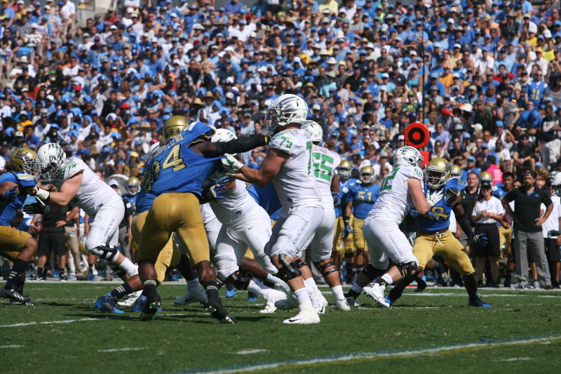 Oregon offensive line opening up some holes against UCLA. Photo: David Pyles