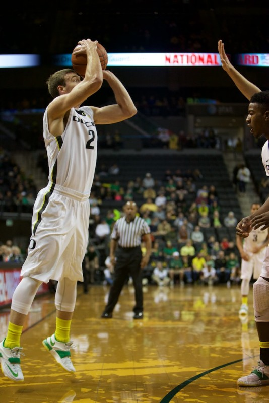Oregon Guard Casey Benson attempting a three pointer against ASU. Photo by: Donald Alarie