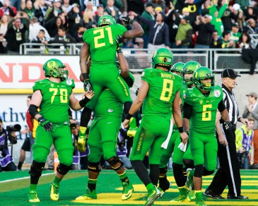 The Oregon team stands united as they prepare for the national championship game against Ohio State.