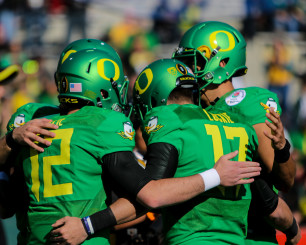 Freshman Taylor Alie, left, and sophomore Jeff Lockie are amongst those vying for the Ducks starting quarterback job.