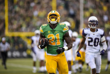 Royce Freeman in the Kenny Wheaton inspired throwback jerseys.