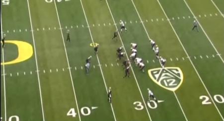 Oregon about to gash Colorado's Cover 2 with an inside handoff