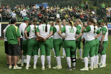 Oregon Softball meets in a huddle